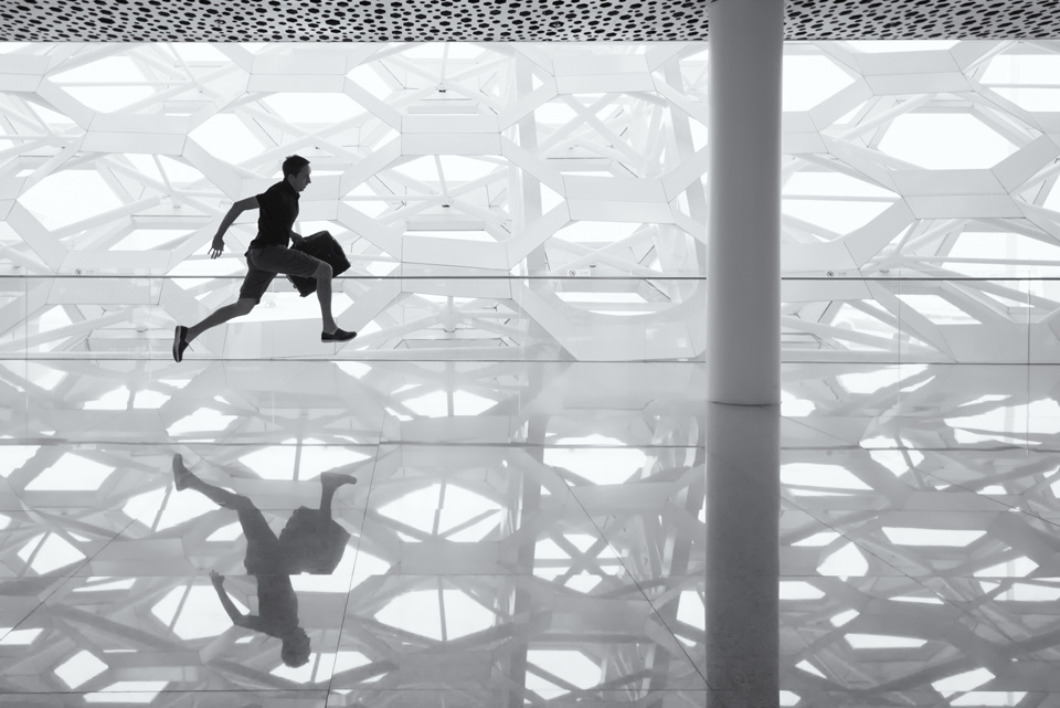 a man running at the airport