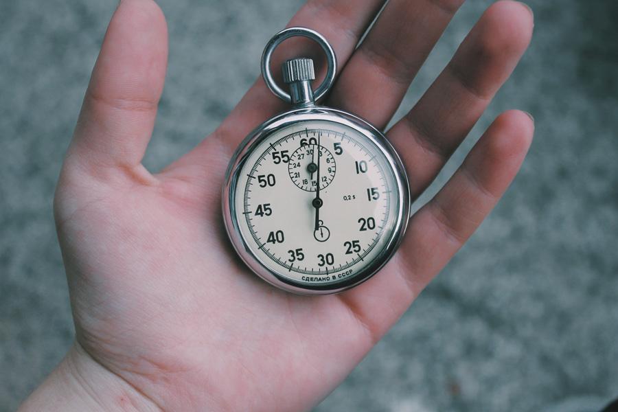 a clock in a hand